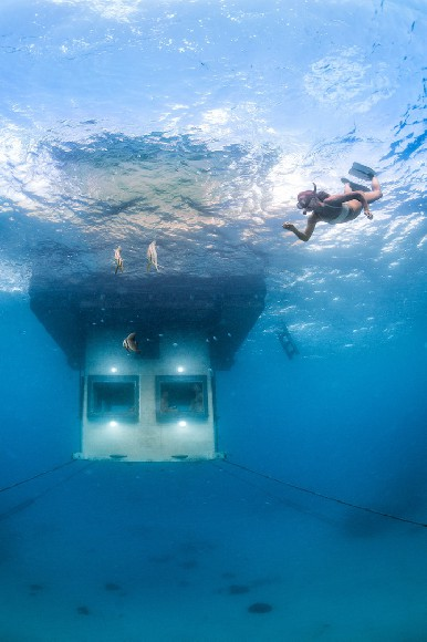 under water view of The Underwater room at the manta resort on Pemba
