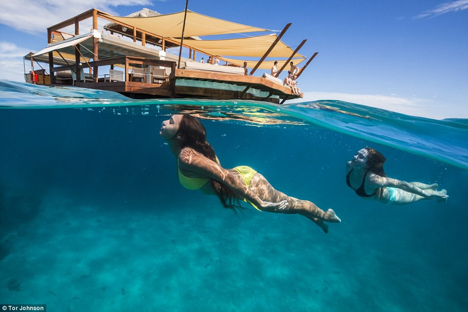 swimming at a slice of paradise the floating pizzeria called Cloud9 near Fiji